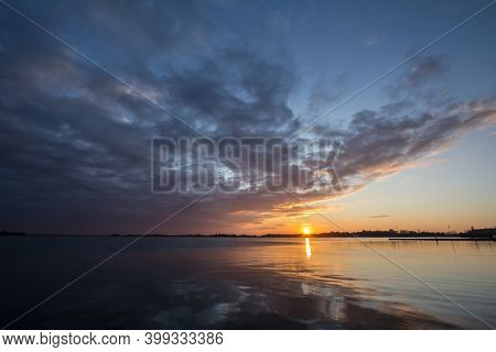 Palic Lake, In Subotica, Serbia, With A Green Lawn In The Background, During An Autumn Sunset. Also