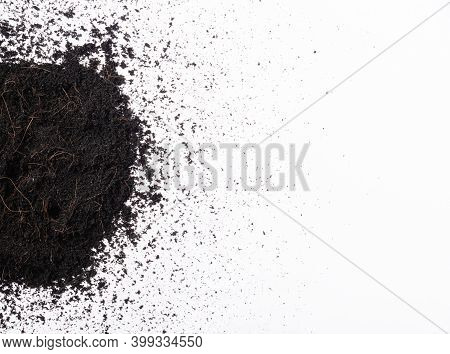 Top View Of Fresh Soil Or Dirt Earth Section With Mulch For Gardening Isolated On White Background,