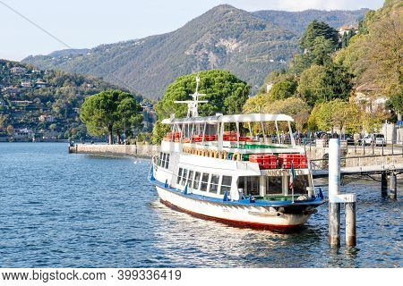 Como, Italy - October, 2019: Conventional Ferry Innominato Stopped At The Dock In Como City. Public