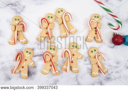 Christmas Butter Cookies Ginger Bread Man Hold Candy Cane