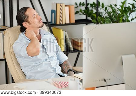 Tired Graphic Designer Feels Fatigue Massaging Tensed Muscles Of Stiff Neck Trying To Relieve Pain A