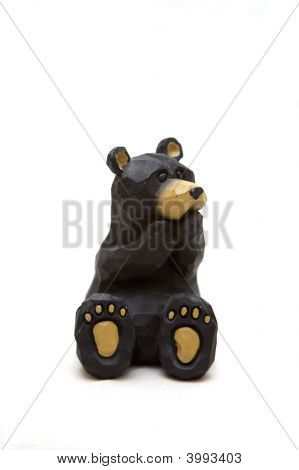 Cute little toy bear covering mouth on a white background poster