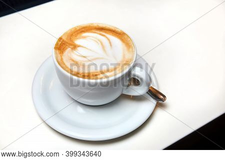 A Cup Of Coffee. Latte With Heart Pattern In A White Cup