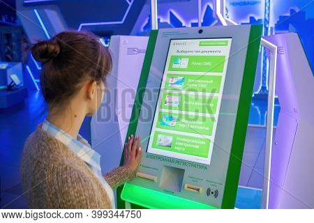 Moscow, Russia - June 05, 2019: Technology Exhibition. Woman Using Interactive Touchscreen Display O