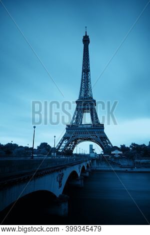 Eiffel Tower with bridge in River Seine in Paris, France.