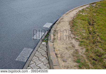 Run-over Edges With Tracks From Heavy Trucks. A Poorly Designed Turn Radius Means Damage To Curbs, C