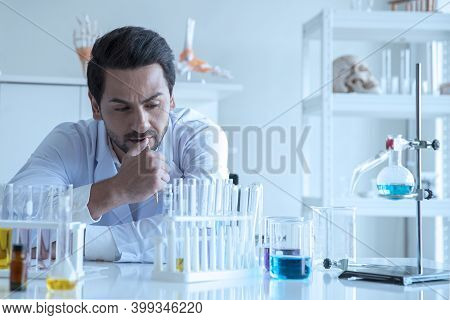 Attractive Scientist Medical Worker With Sample Test Tube At Laboratory , Doing A Analysis In A Labo