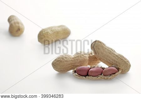 Peanuts In Shells Isolated On White Background, Peeled Peanuts, Ripe Peanut Kernels Close-up