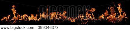 Texture of real fire flames and sparks isolated on black background