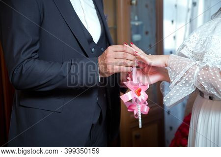 Newlyweds Exchange Rings, Groom Puts The Ring On The Brides Hand In Marriage Registry Office . The B