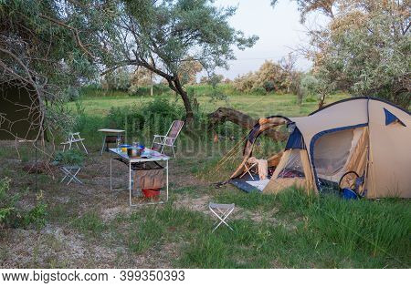 Camping Tent On The Beach. Adventure Camping Tourism And Tents And Cars By The Sea Or Lake.