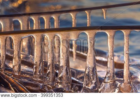 Background Of Icicles In The Sunset Light