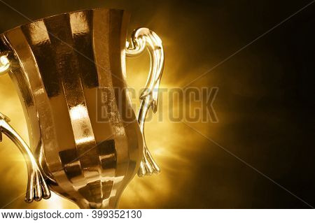 Champion Golden Trophy Cup On Dark Background