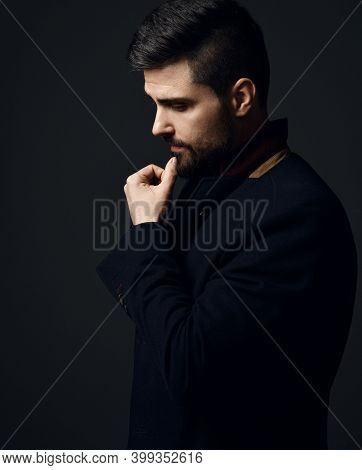 Profile Of Thoughtful Bearded Businessman Modern Intellectual In Jacket Holding Hand At Chin Looking