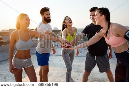 Fitness, Sport, Training And Lifestyle Concept. Group Of Smiling People Exercising Outdoor