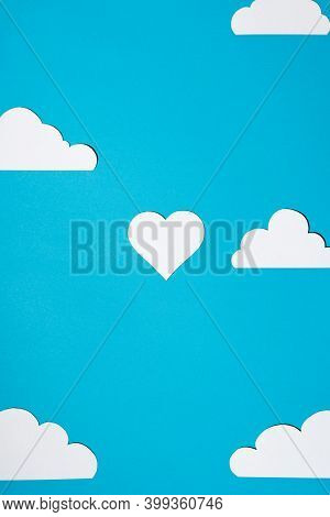 Heart And Clouds Cut From Paper On A Blue Background. Flat Lay, Top View. Concept Of Love, Celebrati