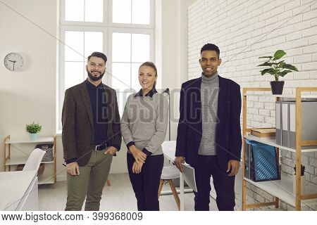 Portrait Of Happy Young Colleagues, Company Trainees, Managers Or Business Partners