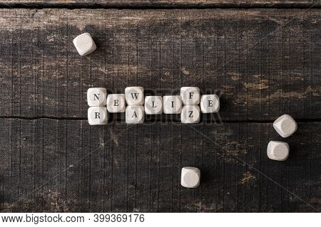 Word Game Of Words Realize And New Life Spelled On Wooden Dices In A Conceptual Image.