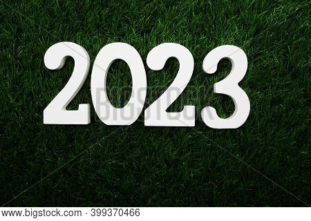 2023 Happy New Year Flat Lay On Green Artificial Grass