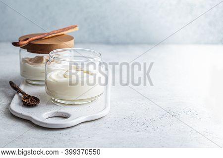 Homemade Yogurt In Glass Jars, Light Background. Yoghurt Cooking Concept.
