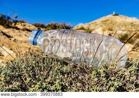 Plastic Empty Water Bottle Abandoned On Nature