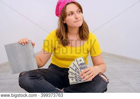 Woman Worker Looks Thoughtfully To The Side. Problems With Spending Money On Apartment Renovation. N