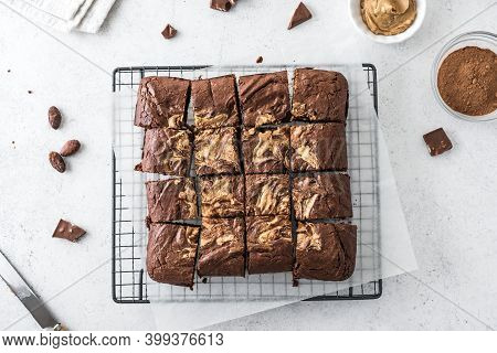 Fresh Brownies On White. Delicious Homemade Chocolate Dessert, Pie Brownie With Peanut Butter, Top V
