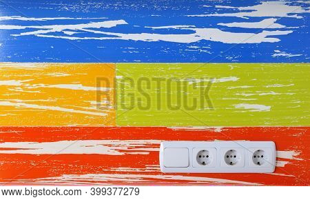 Ac Power Electrical Sockets And Light Switch On A Bright Abstract Wall Background