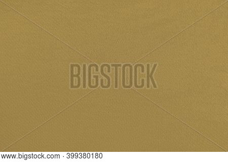 Ocher Homogeneous Background With A Textured Surface, Fabric.