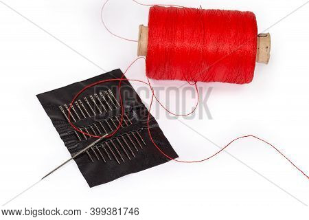 Hand Sewing Needle With Inserted Thread In Eye With Easy Threading Opening Lies On Set Of The Same N