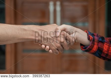 Close Up Of Male And Female Hands Shaking Hands