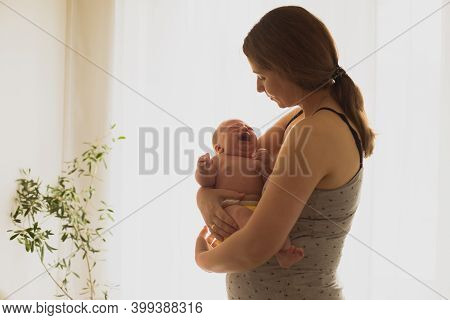 Woman In Postpartum Depression Feeling Unemotional And Exhausted