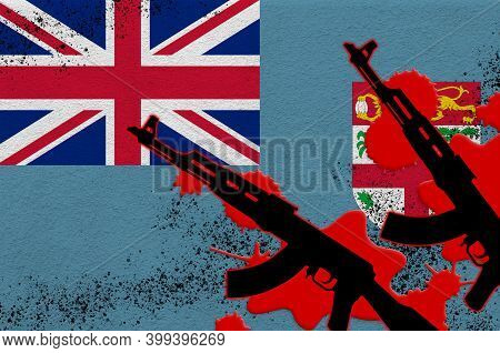 Fiji Flag And Two Black Ak-47 Rifles In Red Blood. Concept For Terror Attack Or Military Operations