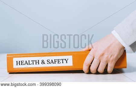 Health And Safety Labor Protection And Regulations At Work Place. Folder With Documents Or Instructi