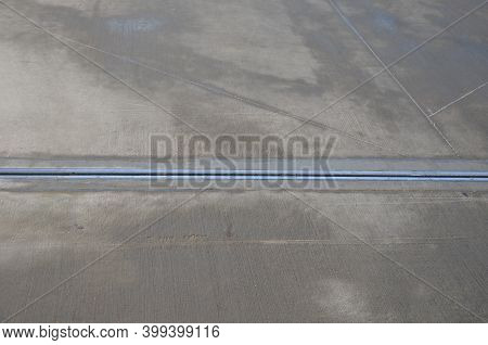 Expansion Joint On The Concrete Roof Which Serves As A Parking Lot. Dilatation Consists Of A Rubber