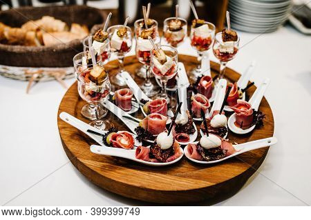 Gourmet Appetizers On Plastic Spoons, Variety Of Mini Appetizer With Different Toppings On Plate. Fr