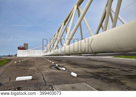 Huge steel structures of the storm surge barrier Maeslantkering near Rotterdam, protecting the Netherlands against flooding as part of the Delta Works project