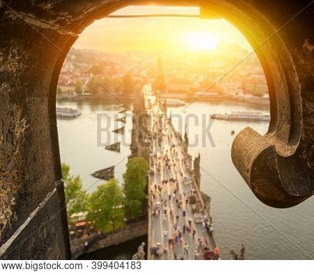 View On Charles Bridge In Prague At Sunset From Above