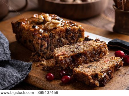 Fruitcake Loaf Sliced On A Rustic Wooden Cutting Board