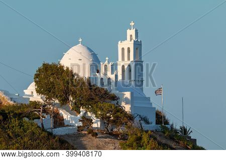 View Of The Agia Irini, Saint Irene, Greek Orthodox Church, Traditional White Building. Beautiful Su