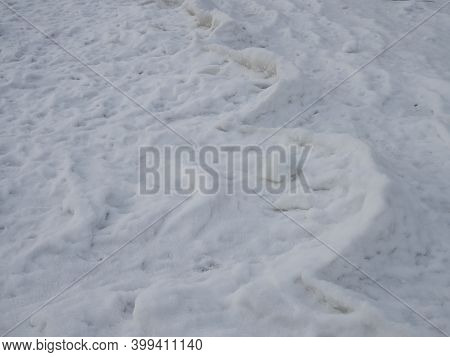 Waves Of Ice In The Coastal Strip Of The River In Winter, An Interesting Phenomenon Of Nature