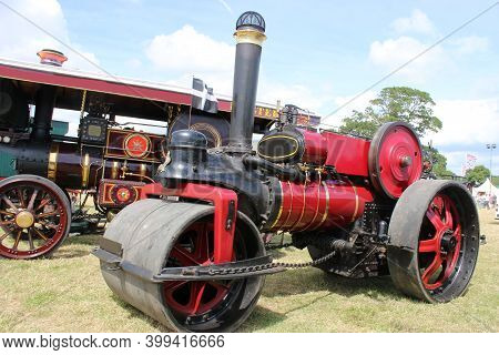 Vintage Steam Traction Engine In A Field