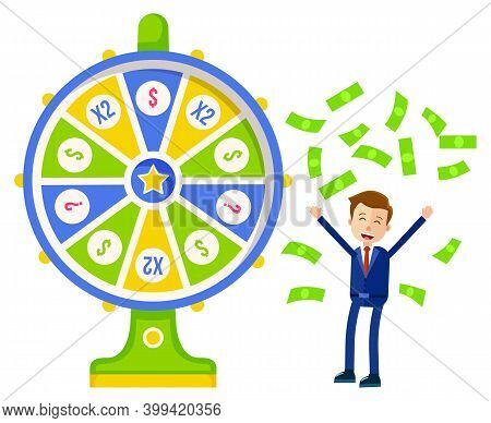 Game Fortune Wheel. Man Playing Risk Game With Fortune Wheel And Lottery. Casino And Gambling Wheel