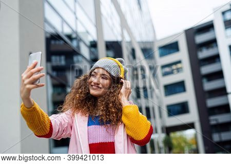 Young Woman With Smartphone Making Video Outdoors On Street, Tik Tok Concept.