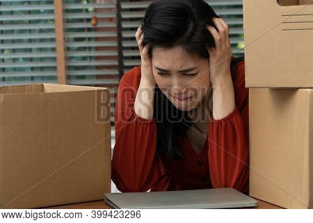 Sad Asian Woman Packing Belongings In A Cardboard Box And Crying On The Desk In The Office After Bei