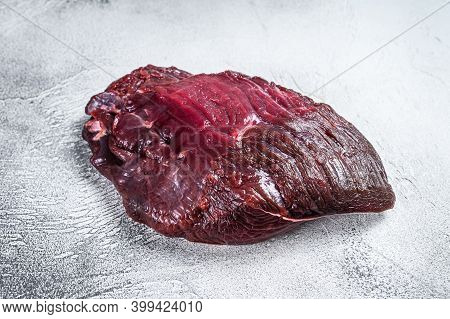 Venison Raw Deer Meat On A Table. White Background. Top View