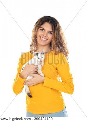 Cute young woman holding her cat isolated on a white background