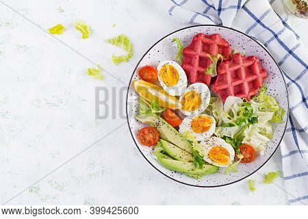 Breakfast With Beetroot Waffles, Boiled Egg, Tomato And Slice Avocado On White Background. Appetizer