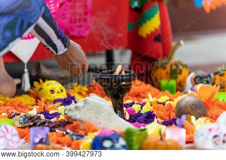 Selective Focus Of Male Hands Lighting Candle Lying Between Decorated Catrina And Campasuchil While