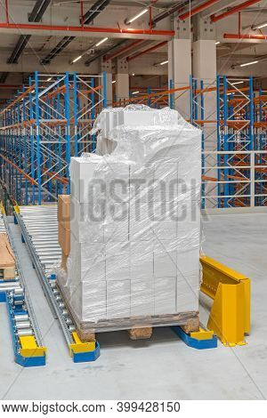 Pallet With Boxes At Floor Mountet Gravity Flow In Distribution Warehouse